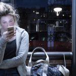 Young woman staring at phone