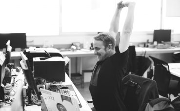 Man stretching at desk