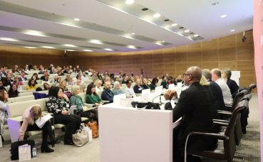 View of audience & panel at The Wellbeing Symposium